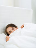 Female hiding behind blanket Royalty Free Stock Photography