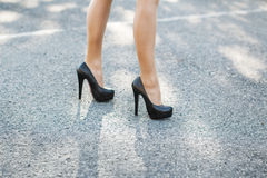 Female high heeled red shoes on the way Royalty Free Stock Image
