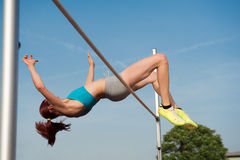 Female high jumper in action Royalty Free Stock Images