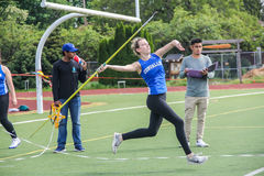 Female high school athlete throws the javelin. Corvallis, OR, May 7 2016: female high school athlete throws the javelin Royalty Free Stock Images