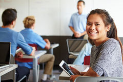 Free Female High School Student Digital Tablet In Classroom Stock Photos - 52846753