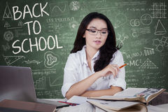 Female high school student learning in class Stock Image