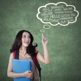 Female high school student learns foreign language Stock Photo