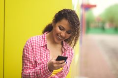 Female High School Student By Lockers Using Mobile Phone. Female High School Student By Lockers Using Mobile Stock Images