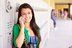 Female High School Student By Lockers Using Mobile Phone Royalty Free Stock Image