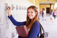 Female High School Student Opening Locker Stock Images
