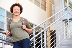 Female High School Student Standing Outside Building Stock Photo