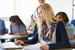 Female High School Student Using Laptop In Class Royalty Free Stock Photos