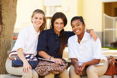 Female High School Students Hanging Out On School Campus Royalty Free Stock Photos