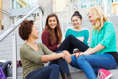 Female High School Students Sitting Outside Building Royalty Free Stock Photography