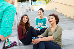 Female High School Students Sitting Outside Building Royalty Free Stock Photos