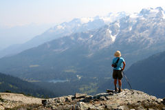 Female Hiker Above Conflict Lake. Female hiker standing above Callaghan Valley. British Columbia. Canada Stock Photography