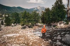Backpacker on the way to Tahtali mountain. Turkey. Female hiker on a background of evergreen Tahtali Royalty Free Stock Photos