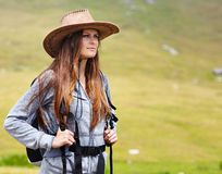 Female hiker with backpack and hat Royalty Free Stock Image