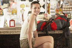 Female Hiker With Backpack Sitting In Bar Stock Photography