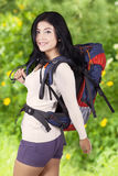 Female hiker with backpack in woods Royalty Free Stock Photo