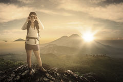 Female hiker with binoculars at mountain Stock Photos
