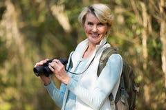 Female hiker binoculars. Portrait of beautiful female hiker with binoculars Stock Images
