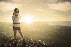 Female hiker and camera with valley view Stock Photography