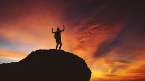 Female hiker celebrating her success on the hill stock images