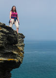 Female hiker on cliff edge near Tintagel Cornwall royalty free stock images