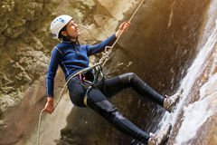 Female hiker climbing Stock Photos