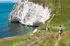 Female Hiker on coastal path Stock Photos