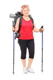 Female hiker with complete hiking equipment on Royalty Free Stock Photos