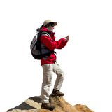 Female hiker consulting map on smart phone. Royalty Free Stock Photos