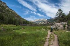 Female hiker on the Cub Lake trailhead in Rocky Mu Stock Image