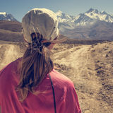 Female hiker deciding which path to take. Stock Photos
