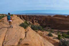 Female hiker on a Devils Garden trail to Double O Arch Royalty Free Stock Image