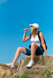 Female hiker drinks water. Royalty Free Stock Photography