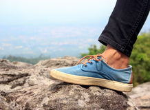 Female hiker feet walking on Mountain. Stock Photo