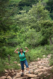 Female hiker flexing on a trail in Costa Rica Stock Photos
