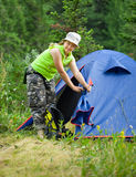 Female hiker in front of camp Stock Images