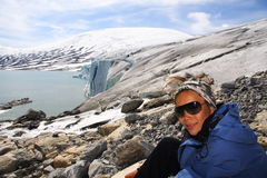 Female hiker on glacier Stock Photo