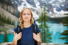 Female hiker with her backpack against scenic view. Portrait of attractive female hiker with her backpack against scenic view royalty free stock image