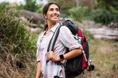 Female hiker hiking in forest. Smiling female hiker hiking in forest Royalty Free Stock Photos