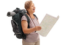 Female hiker holding a map and looking in the distance Royalty Free Stock Photography