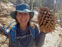 Female Hiker Holds Giant Pinecone