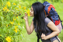 Female hiker kiss a flower Royalty Free Stock Photography