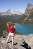 Female hiker at lake ohara Stock Images
