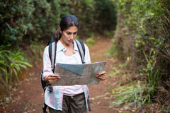 Female hiker looking at map Royalty Free Stock Photo