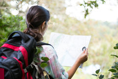 Female hiker looking at map Stock Photos