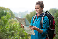 Female hiker looking at map Royalty Free Stock Photography