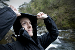 Female hiker looking up at rain Royalty Free Stock Photography