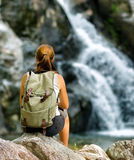 Female hiker looking at waterfall Royalty Free Stock Image