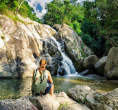 Female hiker looking at waterfall Royalty Free Stock Images