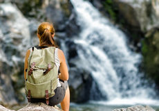Female hiker looking at waterfall Stock Images